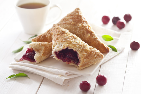 Puff Pastry Cherry Turnovers on desk