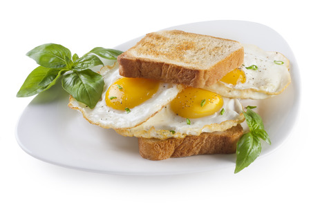 sunny side up: Fried Eggs sandwich on a plate isolated Stock Photo
