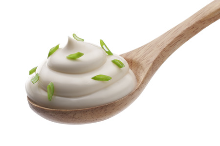 Mayonnaise: Sour cream in wooden spoon isolated Stock Photo