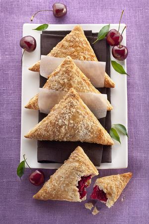 danish puff pastry: Danish Pastry Cherry Turnovers Stock Photo