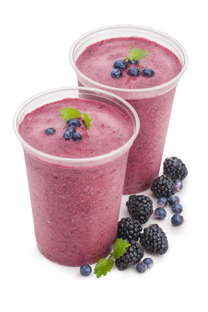 Glass of blackberry smoothie isolated on white background 写真素材