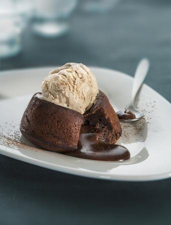 Hot chocolate fondant lava cake pudding with ice cream 写真素材