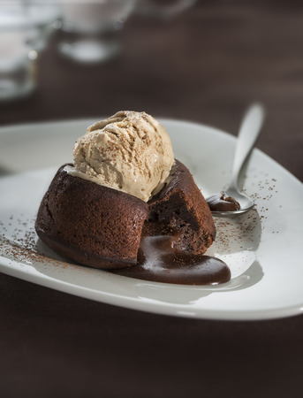 Hot chocolate fondant lava cake pudding with ice cream Stock Photo