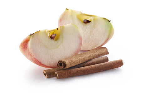 Apple slices with cinnamon isolated on white background