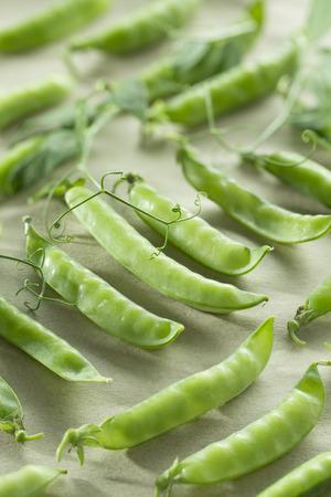 Fresh juicy pods of green peas art 写真素材