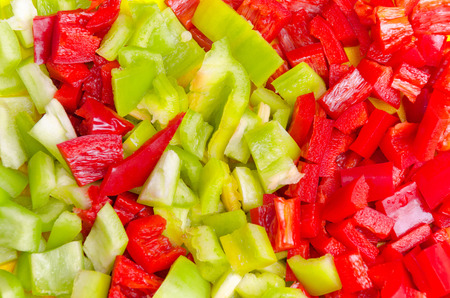 Surface coated with a sweet bell pepper cut into colorful pieces