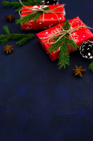 Christmas dark background with christmas decoration, fir branch. Selective focus. Stock Photo