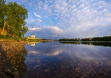 Pskov Kremlin and Velikaya river the Great and Pskov in the evening. Russia. Beautiful sunset with reflection in the river.