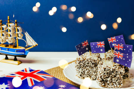 Iconic traditional Australian party food, Lamington cakes on a red, white and blue background.