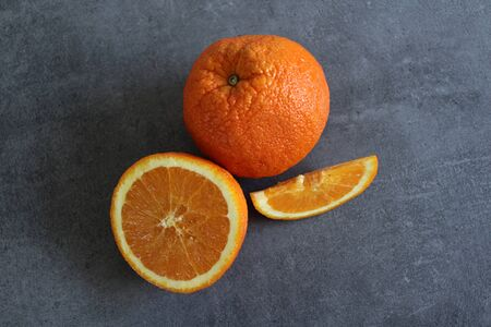 Juicy oranges. Fruit texture close up. Fresh summer fruits on dark background with copy space. Stok Fotoğraf