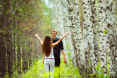 european white birch: Young couples dating at summer birch forest background. Stock Photo