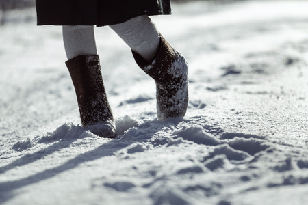 valenki: Closeup image of traditional Russian rural winter footwear valenki at winter outdoors snow background. Stock Photo