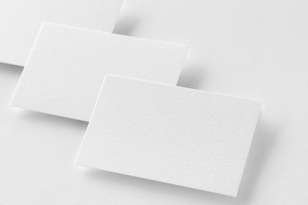 Mockup of three horizontal business cards at white textured paper background. Stock fotó