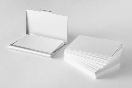 cardholder: Mockup of blank business cards stack and cardholder at white textured background.
