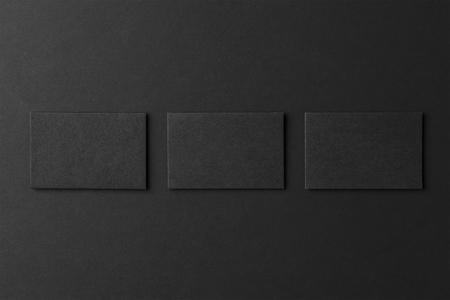 Mockup of three blank business card stacks at black textured background. Stock fotó