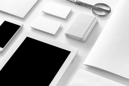 textured paper: Brand identity mockup. Blank corporate stationery and gadgets set at white textured paper background. Stock Photo