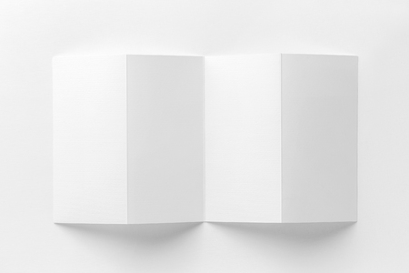 Mockup of opened four fold brochure isolated at white background