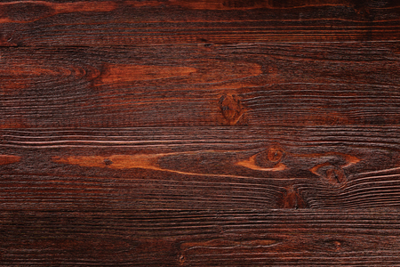 Closeup brown wooden board as natural textured background.