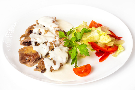 farce: Plate of vegetables and meal of minced meat with mushrooms isolated at white background.