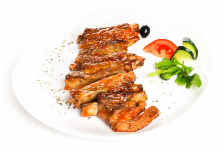 Plate of fried golden chicken wings and legs isolated at white background. Banque d'images