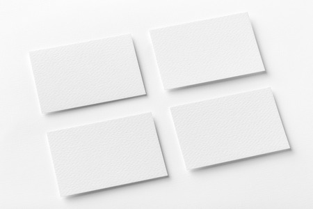 contact info: Mockup of four white business cards arranged in rows at white design paper background.