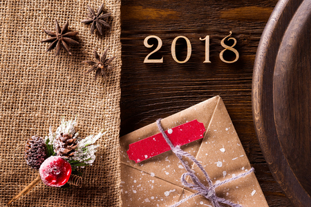Closeup New Year decoration set at wooden table as greeting card background.