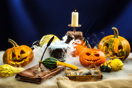 Halloween pumpkins decoration set with deep smoke around. Фото со стока