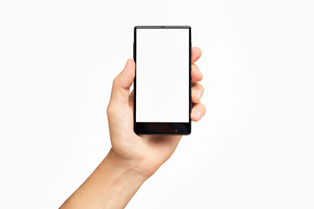 Mockup of male hand holding black frameless cell phone with blank screen isolated at white background.