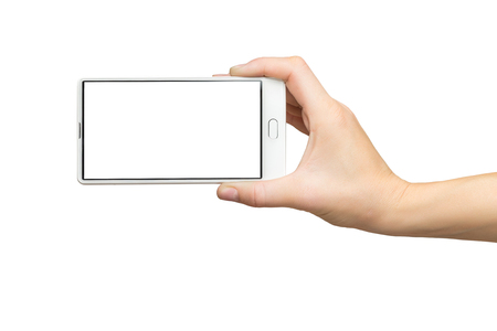 Mockup of female hand holding white frameless cell phone with blank screen isolated at white background.