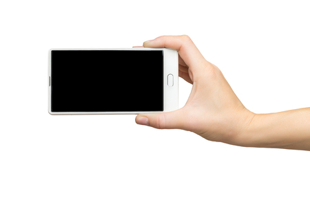 Mockup of female hand holding white frameless cell phone with black screen isolated at white background.