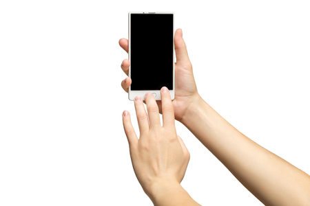 Mockup of female hands holding modern white cellphone with black screen and making sliding gesture isolated at white background.