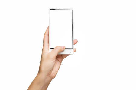Mockup of female hand holding frameless cell phone with blank screen isolated at white background.