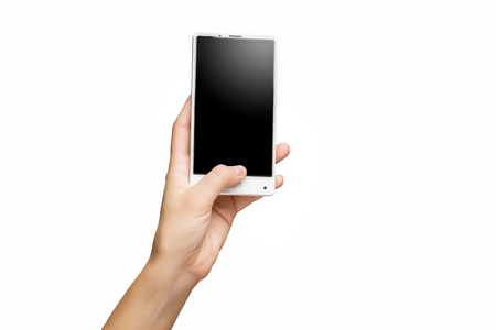 Mockup of female hand holding frameless cell phone with black screen isolated at white background. Banque d'images