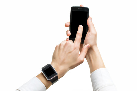 Mockup of male hands with cellphone and smart watch with black screens isolated.