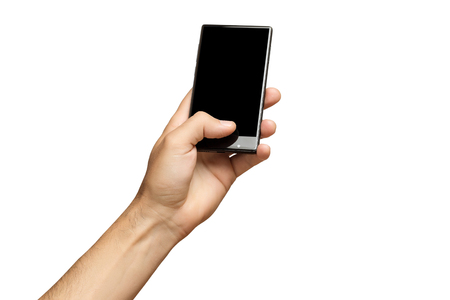 Mockup of male hand holding black frameless cell phone with black screen isolated at white background. Banque d'images