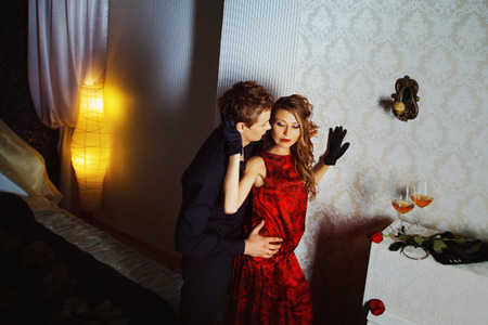 Young lovers are passionately embracing in bedroom. Concept of happy family.