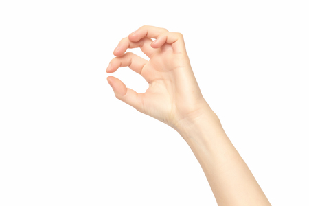 Female hand isolated at white background making picking gesture.