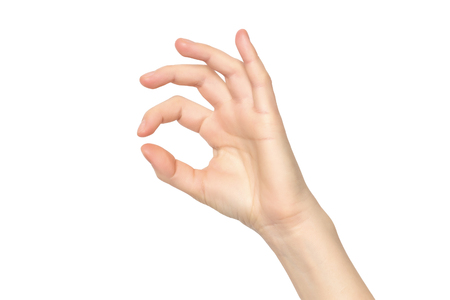 Female hand isolated at white background making OK gesture.