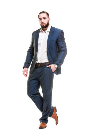 Vertical portrait of smart bearded businessman in suit isolated at white background.