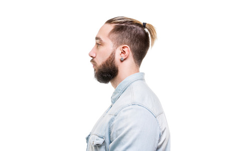 Closeup side view portrait of bearded stylish man dressed in shirt isolated at white background. Stock Photo