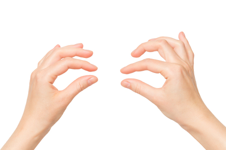 Female hands holding invisible object isolated at white background.