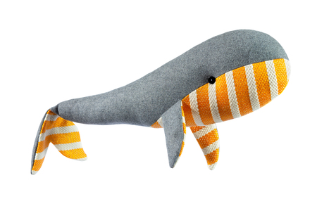 Closeup image of handmade toy whale pillow with ornament isolated at white background. Фото со стока