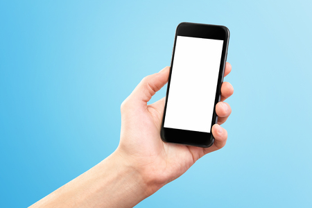 Mockup of male hand holding black cellphone isolated at blue background. Kho ảnh