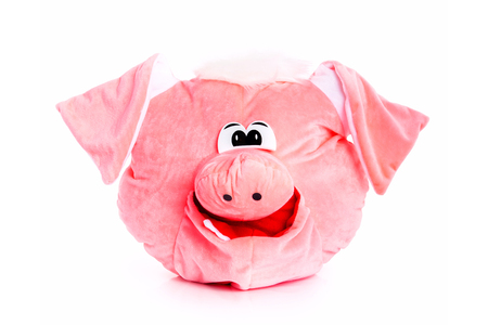 Pink soft stuffed toy pig isolated at white background.