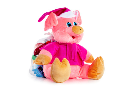 Pink soft toy pig bag isolated at white background.