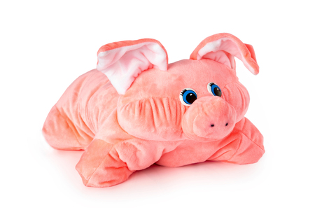 Pink soft stuffed toy pig pillow isolated at white background.