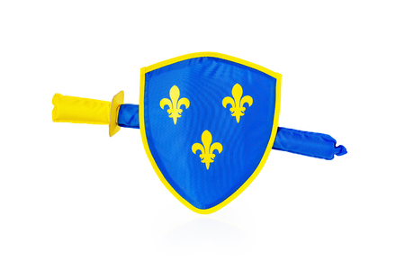 Soft toy shield and sword of blue and yellow colors isolated at white background.