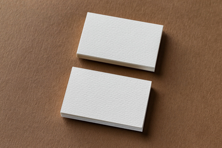 Mockup of two white business cards stacks at craft textured paper background. Kho ảnh