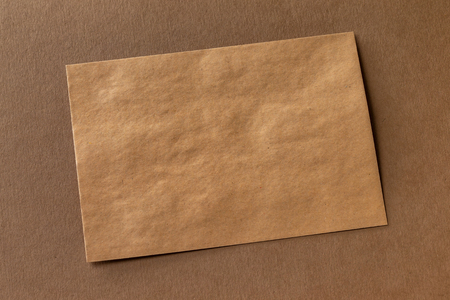 Mockup of craft paper letterhead at brown textured paper background. Kho ảnh