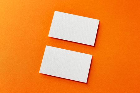 Mockup of two horizontal white blank business cards isolated at orange paper background. Kho ảnh